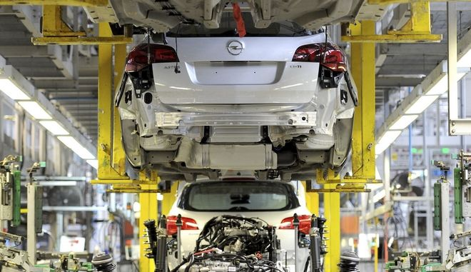 FILE - This is a March 21, 2011  file photo of the Vauxhall Astra production line at the Vauxhall Motors factory in Ellesmere Port, northwest England.  General Motors is selling its unprofitable European car business to the French maker of Peugeot, marking the American company's retreat from a major market and raising concerns of job cuts in the region. With the 2.2 billion euro ($2.33 billion) deal announced Monday, GM is giving up brands  Opel in Germany and Vauxhall in Britain  that have given it a foothold in the world's third-largest auto market since the 1920s. (Martin Rickett/PA, File via AP)