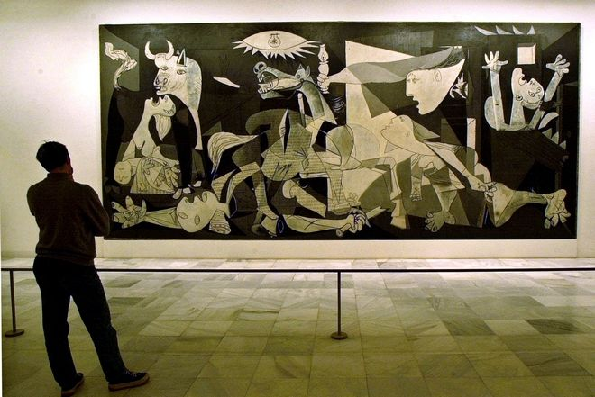 ** FILE  ** A person views Spanish artist Pablo Picasso's world famous painting