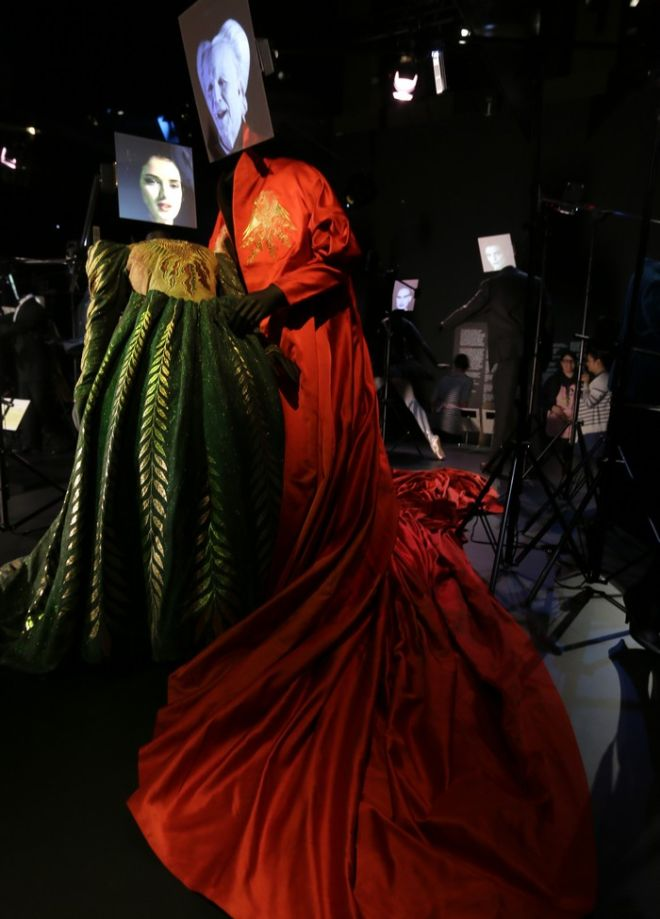 Two costumes made for the 1992 film Bram Stoker's Dracula, by designer Eiko Ishioka, showing a dress worn by the characters Mina Murray/ Elizabeth played actress Winona Ryder and the red cape worn by Count Dracula played by actor Gary Oldman on display at the Hollywood Costume exhibition at the Victoria and Albert museum in London, Tuesday, Oct. 16, 2012. The show at the Victoria and Albert Museum showcases more than one hundred movie costumes from a century of film-making. The exhibition opens to the public on Oct. 20, 2012 and run till 27 Jan. 2013.(AP Photo/Alastair Grant)