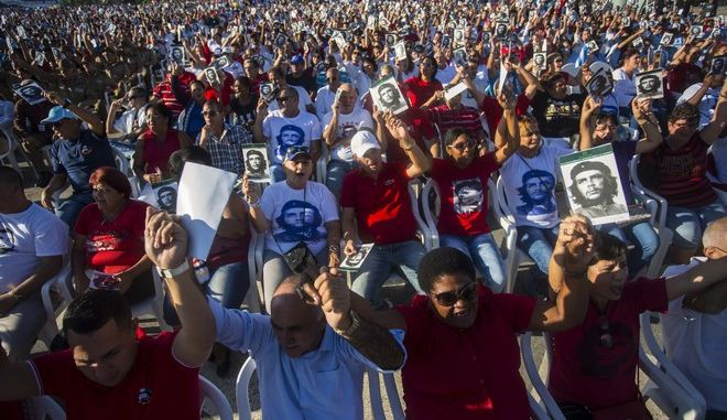 People attend an event paying tribute to Cuban Revolution hero Ernesto Che Guevara marking the 50th anniversary of his death in Santa Clara, Cuba, Sunday, Oct. 8, 2017. (AP Photo/Desmond Boylan)