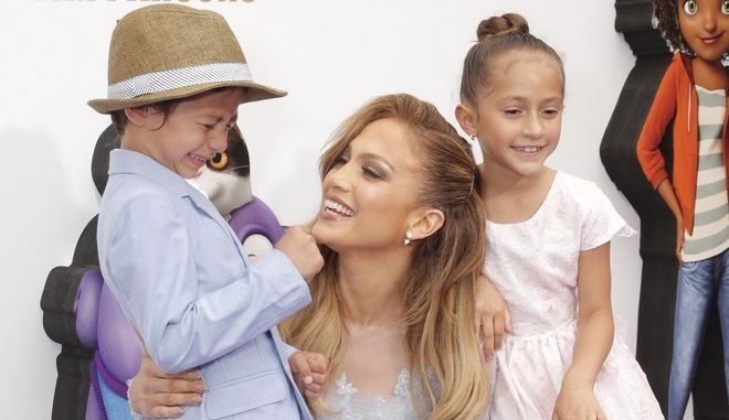 """Maximilian David Muniz, Jennifer Lopez and Emme Maribel Muniz attend the Los Angeles Premiere of """"Home"""" at the Regency Village Theatre on Sunday, March 22, 2015, in Westwood, Calif. (Photo by Todd Williamson/Invision/AP)"""