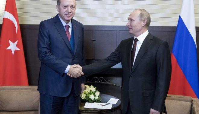 Russian President Vladimir Putin, right, shakes hands with Turkish President Recep Tayyip Erdogan during their meeting in the Bocharov Ruchei residence in the Black Sea resort of Sochi, Russia, Monday, Nov. 13, 2017. (AP Photo/Pavel Golovkin, Pool)