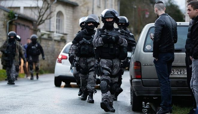 French police officers patrol north of Paris during the manhunt for the gunmen in the shooting at the satirical French magazine Charlie Hebdo headquarters on Thursday, Jan. 8, 2015. The two suspects reportedly robbed a gas station in the north of France. (Arnaud Dumontier/Maxppp/Zuma Press/TNS)