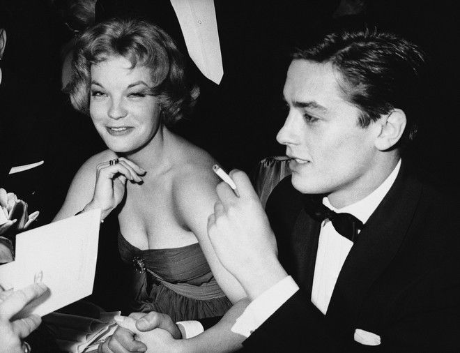 Romy Schneider and French actor Alain Delon, recently engaged, sit with friends attending the Easter Gala on March 30, 1959 at the Sporting Club of Monaco. (AP Photo)
