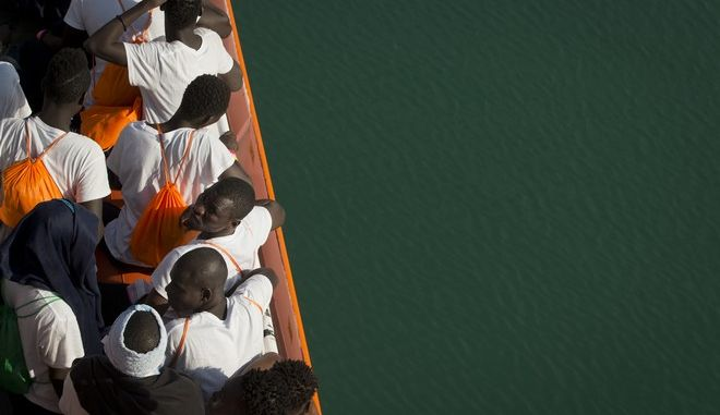 African migrants who were rescued from the Mediterranean Sea north of Libyan coast, stand on the deck as the Aquarius vessel of SOS Mediterranee and MSF (Doctors Without Borders) NGOs, approaches the port of Pozzallo on Sicily, Italy, Friday, Sept. 1, 2017. (AP Photo/Darko Bandic)