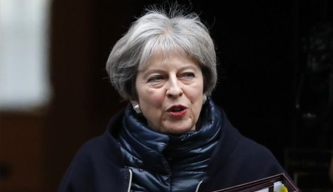 Britain's Prime Minister Theresa May leaves 10 Downing Street to attend the weekly Prime Ministers' Questions session, in parliament in London, Wednesday, Jan. 10, 2018. (AP Photo/Frank Augstein)