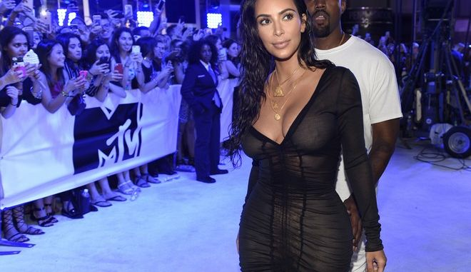 Kim Kardashian West, left, and Kanye West arrive at the MTV Video Music Awards at Madison Square Garden on Sunday, Aug. 28, 2016, in New York. (Photo by Chris Pizzello/Invision/AP)