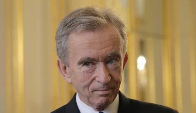CEO of LVMH Bernard Arnault listening at the global tech conference Viva Technology in Paris at the Elysee Palace in Paris, Tuesday, Feb. 21, 2017. (AP Photo/Michel Euler, Pool)