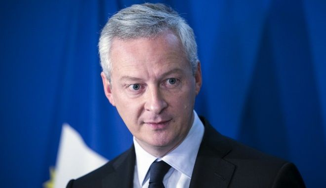 French Economy Minister Bruno Le Maire gives a press conference in Paris, Wednesday, Sept. 27, 2017. Le Maire is defending a deal to merge French high-speed train maker Alstom with Germany's Seimens as crucial to keeping European industry globally competitive. (AP Photo/Kamil Zihnioglu)