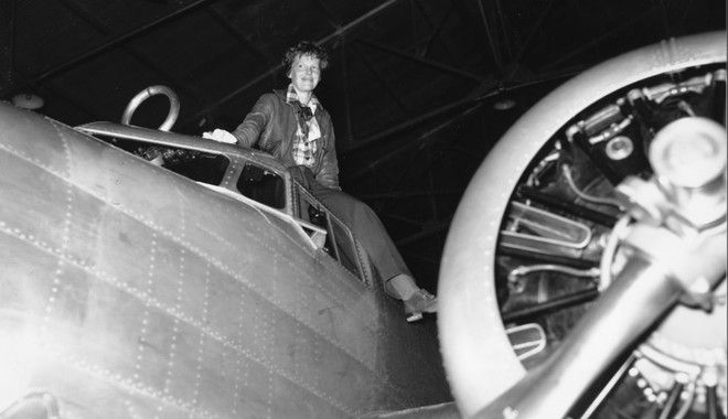 Amelia Earhart is shown climbing out of the cockpit after piloting her plane from Los Angeles to Oakland, Ca., on March 10, 1937.  Earhart and her crew will begin their around-the-world journey from Oakland to Howland Island on March 18.  (AP Photo)
