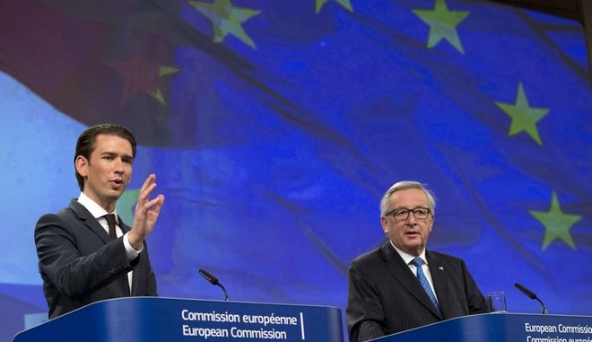 Austrian Chancellor Sebastian Kurz, left, and European Commission President Jean-Claude Juncker address a media conference at EU headquarters in Brussels on Tuesday, Dec. 19, 2017. (AP Photo/Virginia Mayo)