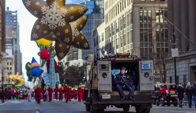 Heavily armed police patrol the parade route during the Thanksgiving Day parade in New York, Thursday, Nov. 23, 2017. (AP Photo/Andres Kudacki)