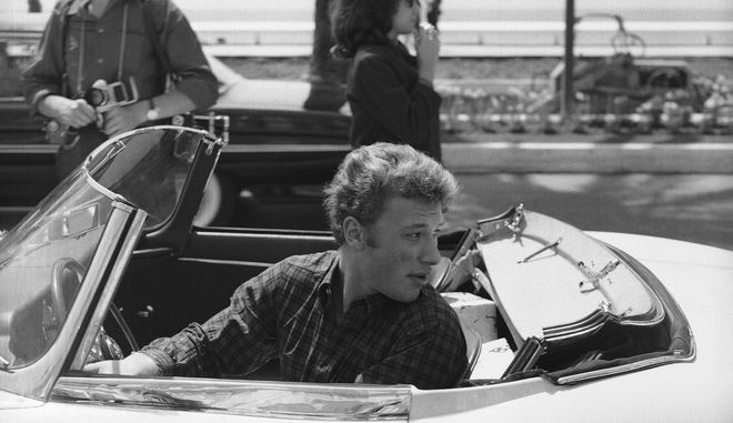 Singer Johnny Hallyday arrives in a sports car at the Carlton Hotel in Cannes, France, on May 16, 1962, for the Cannes Film Festival. (AP Photo)