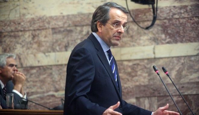 Ο πρόεδρος της Νέας Δημοκρατίας, πρωθυπουργός Αντώνης Σαμαράς, στην ομιλία του στην συνεδρίαση της Κοινοβουλευτικής Ομάδας του κόμματος στην αίθουσα της Γερουσίας της Βουλής την Πέμπτη 30 Ιανουαρίου 2014. (EUROKINISSI/ΑΛΕΞΑΝΔΡΟΣ ΖΩΝΤΑΝΟΣ)