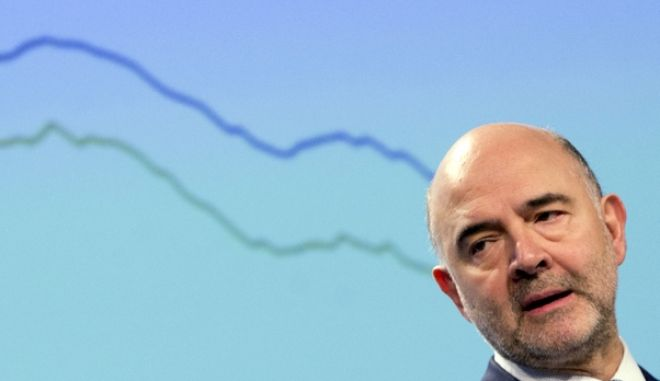 European Commissioner for Economic and Financial Affairs Pierre Moscovici stands in front of a graph as he speaks during a presentation of the winter economic forecast at EU headquarters in Brussels on Monday, Feb. 13, 2017. (AP Photo/Virginia Mayo)