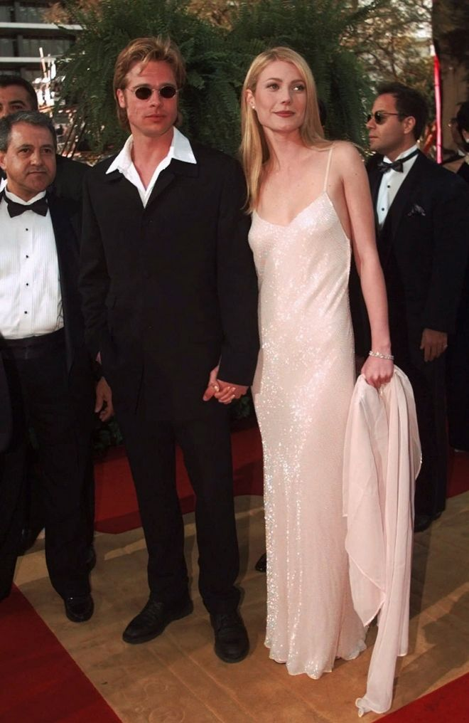 Actress Gwyneth Paltrow and actor Brad Pitt arrive at the Academy Awards in Los Angeles, March 25, 1996.  (AP Photo/Kevork Djansezian)