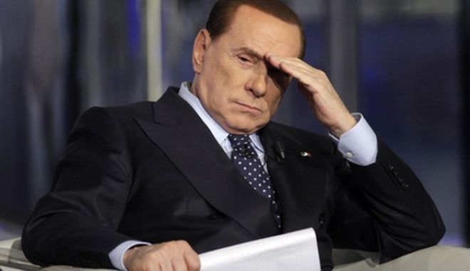 Italy's former Prime Minister Silvio Berlusconi gestures on a television show in Rome in this February 20, 2013 file photo. An Italian court on March 7, 2013 sentenced Berlusconi to a one-year jail term for making public the taped contents of a confidential phone call in a case related to a 2005 banking scandal. REUTERS/Remo Casilli/Files (ITALY - Tags: POLITICS MEDIA CRIME LAW)