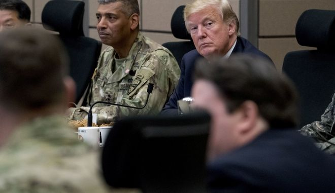 U.S. President Donald Trump, accompanied by United States Forces Korea Commander Gen. Vincent Brooks, center left, attends an operational briefing at the eighth Army Operational Command Center at Camp Humphreys in Pyeongtaek, South Korea, Tuesday, Nov. 7, 2017. Trump is on a five-country trip through Asia traveling to Japan, South Korea, China, Vietnam and the Philippines. (AP Photo/Andrew Harnik)