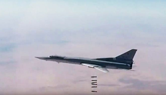 In this photo made from the footage taken from Russian Defense Ministry official web site, a Russian long-range Tu-22M3 bomber strikes the Islamic State targets in Syria, Sunday, Dec. 3, 2017. Syria's main Kurdish forces declared Sunday that they have successfully cleared areas east of the Euphrates river of Islamic State militants, with help from the U.S.-led coalition and Russian forces. (AP Photo/ Russian Defense Ministry Press Service)