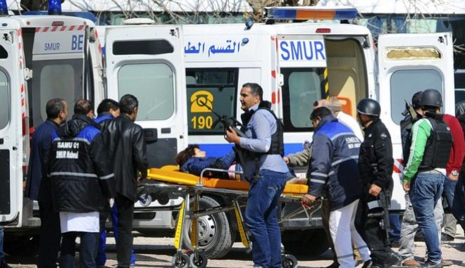A victim is being evacuated by rescue workers outside the Bardo musum in Tunis, Wednesday, March 18, 2015 in Tunis, Tunisia. Gunmen opened fire at a leading museum in Tunisia's capital, killing at least eight people and wounding six, including foreign tourists, authorities said. A later raid by security forces left two gunmen and one security officer dead but ended the standoff, Tunisian authorities said. (AP Photo/Hassene Dridi)