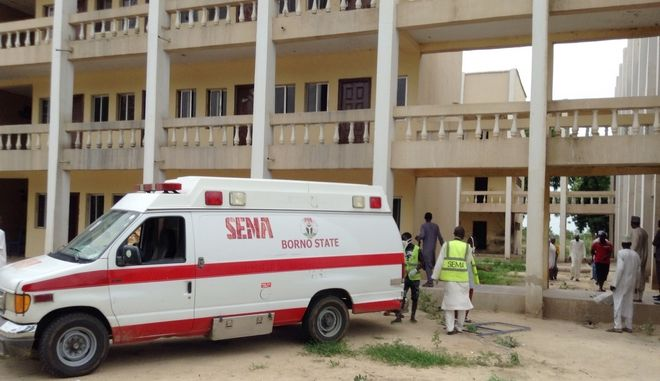 Am ambulance is station at the university of Maiduguri following a suicide attack at the University in Maiduguri, Nigeria, Monday, July 24, 2017.  Female suicide bombers attacked two camps for displaced people in northeastern Nigeria's main city, leaving many dead and injured Monday according to a civilian self-defense group.(AP Photo/Makama Sule)