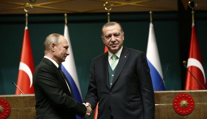 Turkey's President Recep Tayyip Erdogan, right, shakes hands with Russia's President Vladimir Putin, left, following their joint news statement after their meeting at the Presidential Palace in Ankara, Monday, Dec. 11, 2017. The two men met Monday evening to discuss developments in Syria and the Middle East, as well as bilateral relations, according to the Turkish President's office. (AP Photo/Burhan Ozbilici)