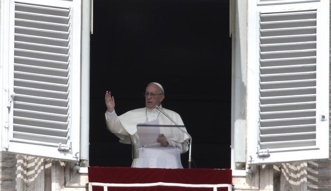 Pope Francis delivers his blessing during the Angelus noon prayer from the window of his studio overlooking St. Peter's Square, at the Vatican, Sunday, Sept. 24, 2017. (AP Photo/Alessandra Tarantino)