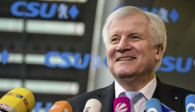 Bavarian Governor Horst Seehofer of the Christian Social Union, CSU, talks to media prior to the party's board meeting in Munich, southern Germany. The smallest of the parties in Germanys prospective new government has signed off on this weeks coalition deal, but bigger hurdles lie ahead. The deal would see Chancellor Angela Merkels conservative Christian Democratic Union and its Bavaria-only sister party CSU continue their four-year partnership with the center-left Social Democrats. (Matthias Balk/dpa via AP)