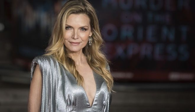 Actress Michelle Pfeiffer poses for photographers upon arrival at the World premiere of the film 'Murder On The Orient Express' in London, Thursday, Nov. 2, 2017. (Photo by Vianney Le Caer/Invision/AP)