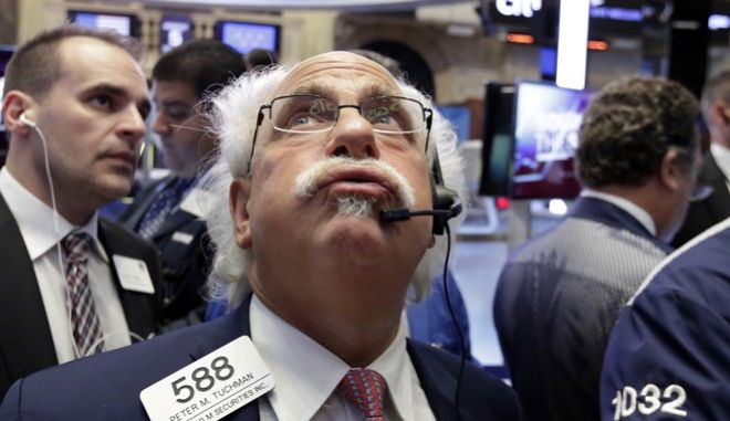 Trader Peter Tuchman, center, works on the floor of the New York Stock Exchange, Wednesday, Oct. 5, 2016. Energy stocks are leading an early gain on Wall Street as the price of crude oil moves higher. (AP Photo/Richard Drew)