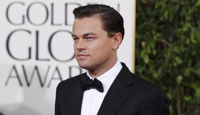 """Actor Leonardo DiCaprio, from the film """"Django Unchained,"""" arrives at the 70th annual Golden Globe Awards in Beverly Hills, California, January 13, 2013.  REUTERS/Mario Anzuoni (UNITED STATES  - Tags: ENTERTAINMENT)  (GOLDENGLOBES-ARRIVALS)"""