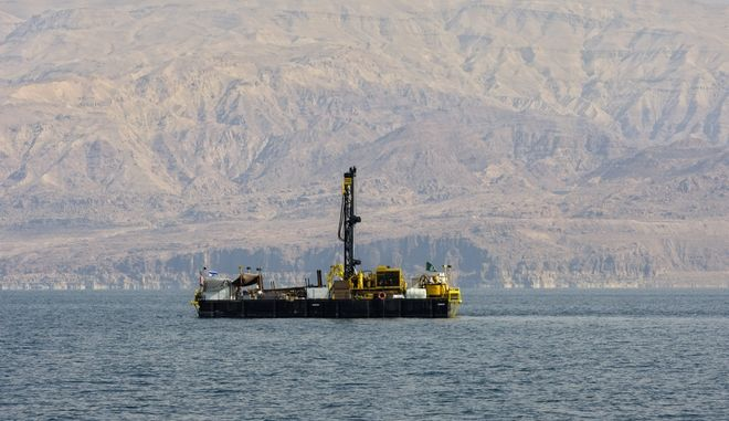 A drilling rig is seen as workers dig for layers of sediment in the bottom of the Dead Sea, Tuesday, Nov. 23, 2010. Scientists in Israel are drilling into the murky depths of the Dead Sea in hopes of unearthing scientific treasures found in 500,000 years worth of mud and sediment. The unique setting of the Dead Sea, the lowest place on earth at 422 meters (1,385 feet) below sea level, should present researchers with distinctly stratified sedimentation that may answer scientific questions ranging from geology to archaeology and could lead to new insight into climate change. (AP Photo/Sebastian Scheiner)