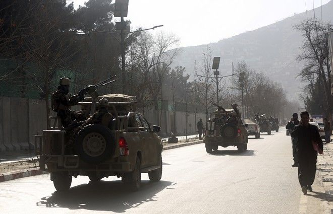 Security forces are driven to the site of a deadly suicide attack in the center of Kabul, Afghanistan, Saturday, Jan. 27, 2018. A suicide car bomber killed at least 40 people and wounded about 140 more in an attack claimed by the Taliban on Saturday in Afghanistan's capital Kabul, authorities said. (AP Photo/Massoud Hossaini)