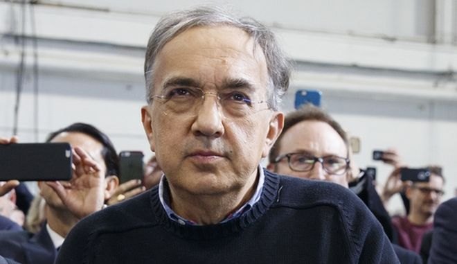 Fiat Chrysler CEO Sergio Marchionne, and others, listens to President Donald Trump speak at the American Center of Mobility, Wednesday, March 15, 2017, in Ypsilanti Township, Mich. (AP Photo/Evan Vucci)