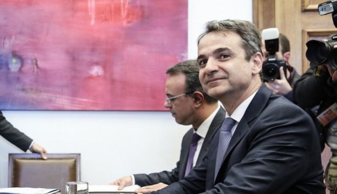 Meeting between the President of New Democracy Party Kyriakos Mitsotakis and the European Commissioner for Economic and Financial Affairs Pierre Moscovici, in Athens, on 15 February, 2017 /                  ,  ,  15 , 2017