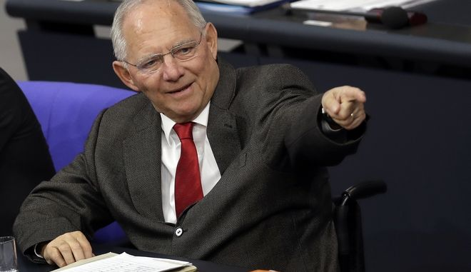 German Finance Minister Wolfgang Schaeuble points during a budget debate as part of a meeting of the German Federal Parliament, Bundestag, at the Reichstag building in Berlin, Germany, Friday, Nov. 25, 2016. (AP Photo/Michael Sohn)