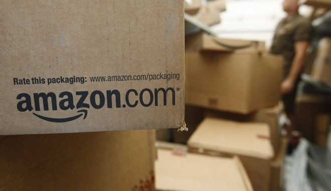 In this Oct. 18, 2010 photo, an Amazon.com package awaits delivery from UPS in Palo Alto, Calif. Amazon.com Inc. reports third-quarter financial results Thursday, Oct. 21, after the market close.(AP Photo/Paul Sakuma)