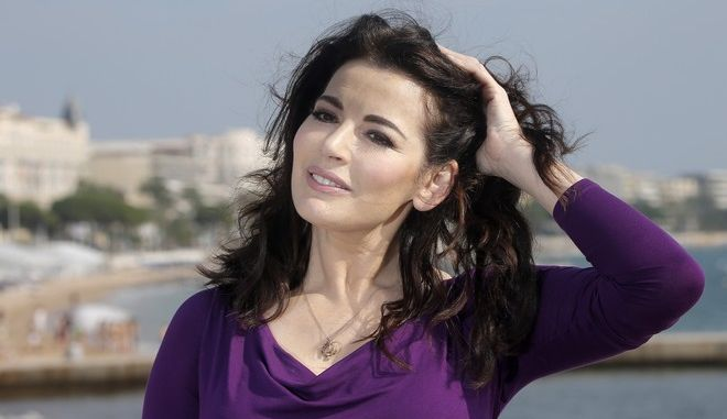 FILE - In this Tuesday, Oct. 9, 2012 file photo, food writer, journalist and broadcaster, Nigella Lawson of Britain poses during the 28th International Film and Programme Market for TV, Video, Cable and Satellite in Cannes, southeastern France. In summer 2013, photos of her husband appearing to choke her surfaced. Then two former employees accused of using the couples credit cards for more than $1 million in fraudulent charges claiming she had sanctioned their spending to hush them up about her heavy drug use. (AP Photo/Lionel Cironneau, File)