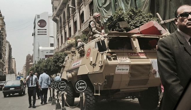 Military soldiers guard a street near a church in downtown Cairo, Egypt, Monday, April 10, 2017. Late Sunday night, President Abdel-Fattah el-Sissi called for a three-month state of emergency after at least 44 people were killed in twin suicide bombings at Palm Sunday services in two separate cities. El-Sissi also dispatched elite troops across the country to protect key installations and accused unidentified countries of fueling instability. (AP Photo/Nariman El-Mofty)