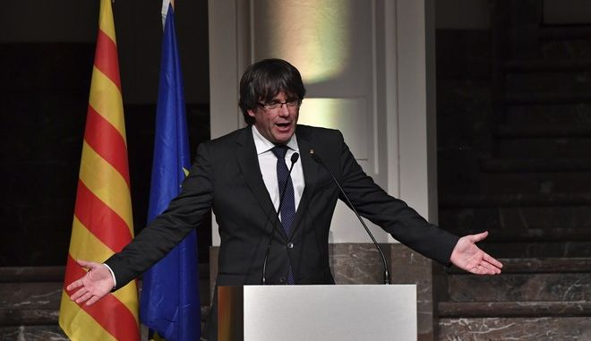 Ousted Catalan leader Carles Puigdemont addresses Catalan mayors who travelled to Brussels to take part in an event in support of the ousted Catalan government in Brussels, Belgium on Tuesday, Nov. 7, 2017. Puigdemont is fighting extradition to Spain, where other members of the ousted Cabinet have been sent to jail while awaiting the results of a probe for allegedly weaving a strategy to secede from Spain. (AP Photo/Geert Vanden Wijngaert)