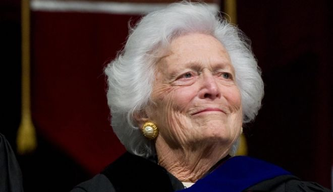 Former President George H.W. Bush reacts alongside Barbara Bush as their son, President George W. Bush delivers the commencement address during the Texas A&M University graduation ceremony at Reed Arena in College Station, Texas, on December 12, 2008. AFP PHOTO/SAUL LOEB (Photo credit should read SAUL LOEB/AFP/Getty Images)