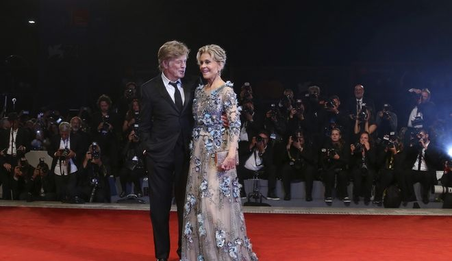 Actors Robert Redford, left, and Jane Fonda pose for photographers at the premiere of the film 'Our Souls At Night' during the 74th edition of the Venice Film Festival in Venice, Italy, Friday, Sept. 1, 2017. (Photo by Joel Ryan/Invision/AP)