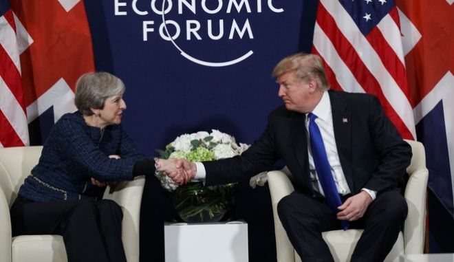 President Donald Trump meets with British Prime Minister Theresa May at the World Economic Forum, Thursday, Jan. 25, 2018, in Davos, Switzerland. (AP Photo/Evan Vucci)