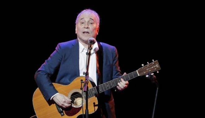 FILE - In a Sept. 22, 2016 file photo, musician Paul Simon performs during the Global Citizen Festival, in New York. On Monday, Feb. 5, 2018, Simon took to social media to say his upcoming tour will be his last, citing the personal toll of touring and the death of his lead guitarist, Vincent N'guini. (AP Photo/Julie Jacobson, File)