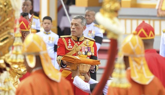 "Thailand's King Maha Vajiralongkorn takes part in the funeral of late Thai King Bhumibol Adulyadej in Bangkok, Thailand, Thursday, Oct. 26, 2017. A ceremony in an ornate throne hall Thursday morning began the transfer of the remains of Thailand's King Bhumibol Adulyadej to his spectacular golden crematorium in the royal quarter of Bangkok after a year of mourning for the monarch Thais hailed as ""Father."" (AP Photo/Kittinun Rodsupan)"