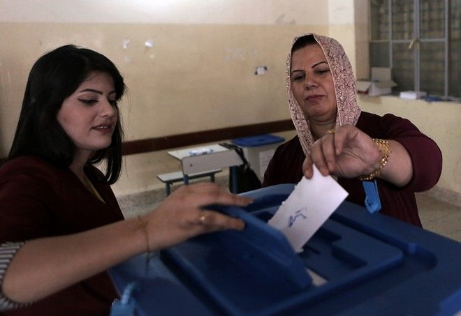 An Iraqi Kurdish woman casts her ballot during the referendum on independence from Iraq in Irbil, Iraq, Monday, Sept. 25, 2017. (AP Photo/Khalid Mohammed)