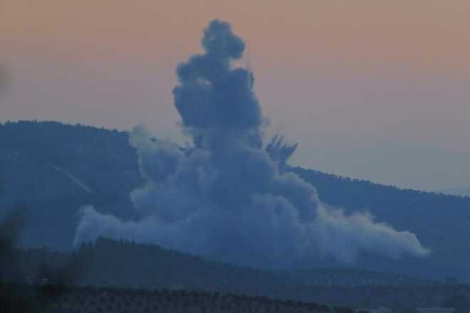 Plumes of smoke and dirt rise on the air from inside Syria, as seen from the outskirts of the border town of Kilis, Turkey, Saturday, Jan. 20, 2018. Turkish jets have begun an aerial offensive, codenamed operation