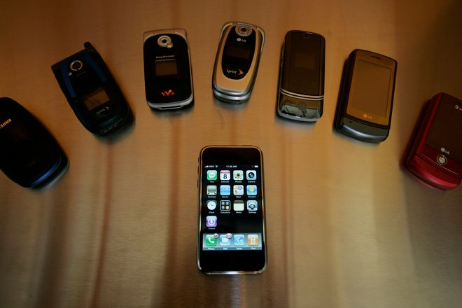 An older Apple iPhone is shown in front of other mobile phones in Palo Alto, Calif., Tuesday, July 8, 2008. To sustain the momentum of the original iPhone's success and keep fickle consumers and Wall Street happy, Apple Inc. needs a dramatic second act with the next generation of iPhones, which roll out Friday with faster Internet access and lower retail prices. (AP Photo/Paul Sakuma)