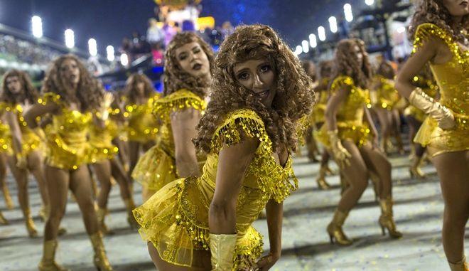 Performers from the Unidos da Tijuca samba school, impersonating U.S. artist Beyonce, parade during Carnival celebrations at the Sambadrome in Rio de Janeiro in Rio de Janeiro, Brazil, Tuesday, Feb. 28, 2017. (AP Photo/Mauro Pimentel)