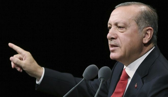 Turkey's President Recep Tayyip Erdogan addresses a police academy graduation ceremony at his palace in Ankara, Turkey, Thursday, Sept. 28, 2017. Erdogan has suggested that Turkey will not deport a U.S. pastor imprisoned in Turkey while Washington refuses to extradite the Turkish cleric Ankara believes masterminded last year's coup attempt. (Pool photo via AP)